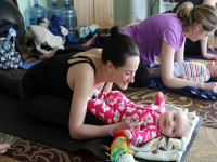 Low-impact yoga poses first for mom and then baby are designed to calm ease digestion-Yoganomics